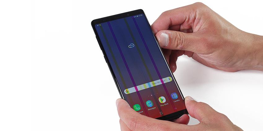 D'où viennent les lignes verticales après changement de mon écran smartphone ?